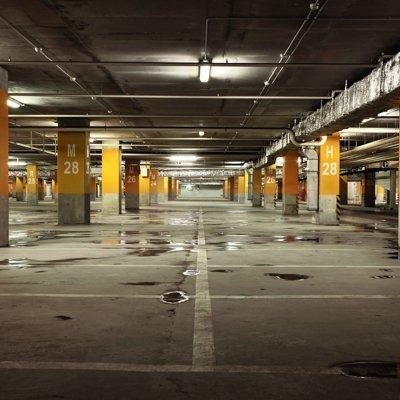 Image of parking garage underground interior, dark industrial building, modern public construction